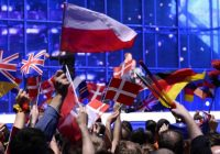 Event attendees waving UK and Europe flags